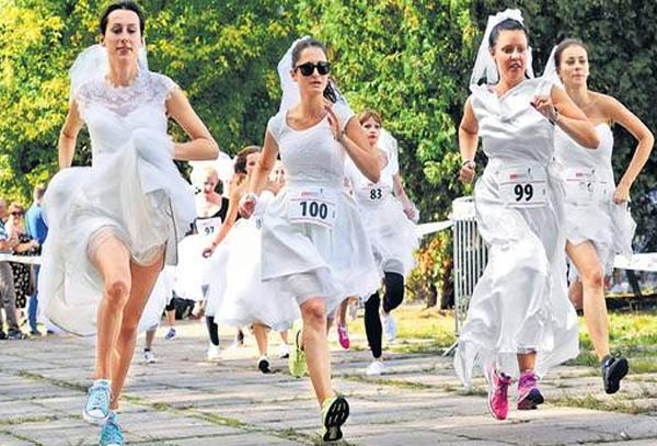 Women in princess style wedding dress run for charity